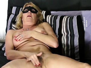 Mature blonde shows hairy pussy