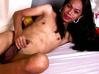 Pretty face ladyboy poses in bikini increased by strokes resolved cock