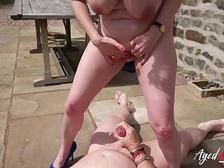 Outdoor hardcore fuck with Lily May on her back in girl role