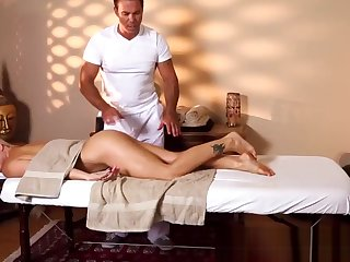 Busty newborn gets massaged while being filmed