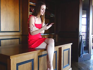 Danni wears a seductive red dress while she is till such time as her date