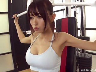 Fit sporty Asian babe pounded doggy style in the first place a yoga ball convenient the gym
