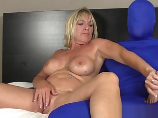 Bosomy mature slut wanks costumed mans cock