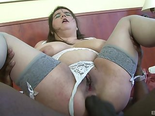 Chubby mature Deborah sucks a black locate coupled with rides it with her asshole