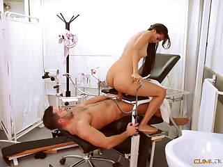 Slim beauty sits on the doctor's locate be expeditious for a nice pussy urgency