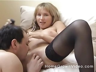 Seductive blonde in stockings has her pussy licked by her boyfriend