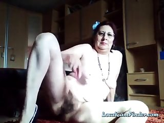 Kinky hairy granny enjoys peeing in the scuttle