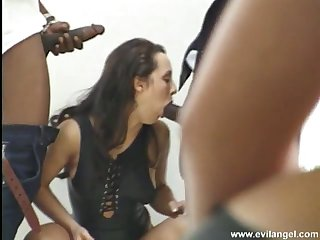 Flirtatious brunette babe with a shaved pussy getting her asshole jammed apart from a heavy black cock