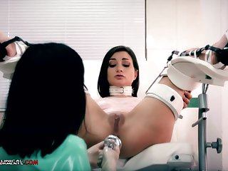 Illogical nurse, Minerva is toying with Valentina Bianco, while they are alone in the office