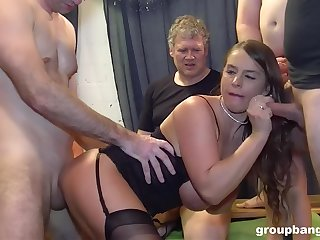 Lively sexpot experiences double-penetration during rough gangbang