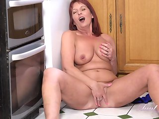 Red haired mommy took off her clothes and started masturbating in the kitchen and enjoying on the same plane