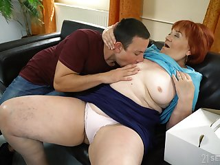 Mature redhead Marsha enjoys making fancy close by a younger lover