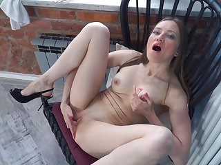 Residence alone Bridget Trace enjoys playing with the brush shaved pussy